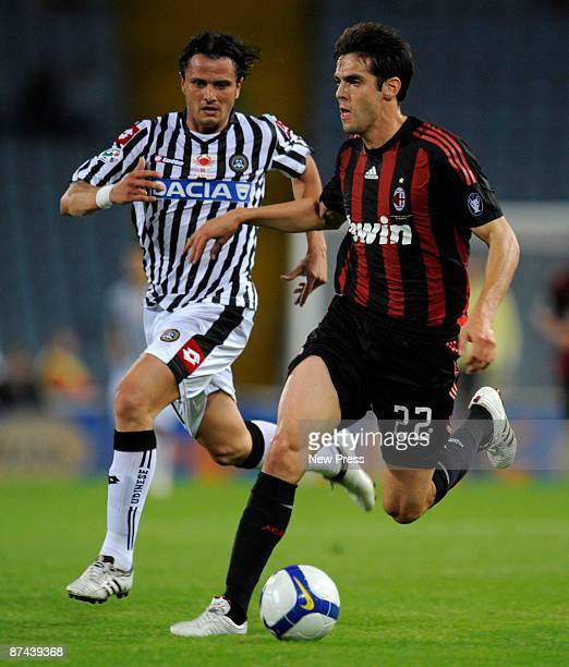 Simone Pepe of Udinese and Kaka of AC Milan in action during the Serie A match between Udinese and AC Milan at the Stadio Friuli on May 16, 2009 in...