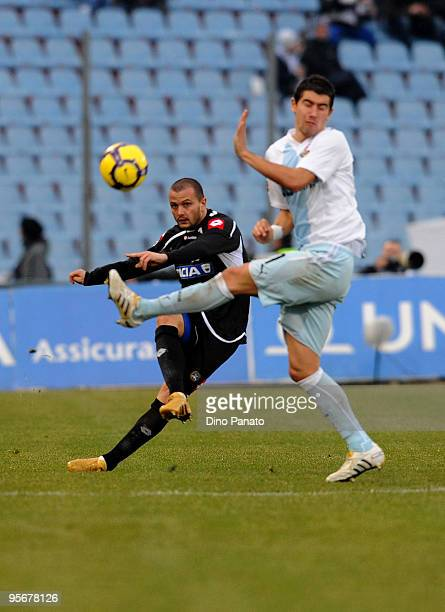 Simone Pepe of Udinese battles for the ball with Aleksandar Kolarov of Lazio during the Serie A match between Udinese and Lazio at Stadio Friuli on...