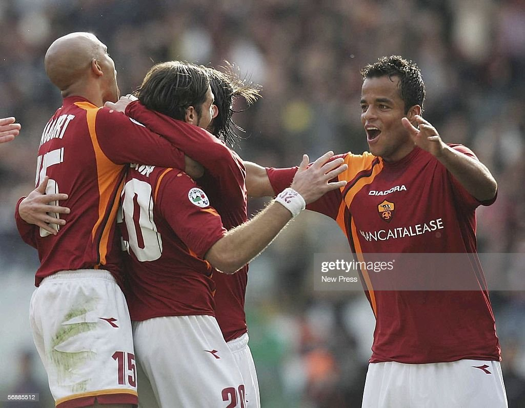 Simone Perrotta celebrates with Alessandro Mancini (R) of Roma after Perotta scored during the Serie A match between AS Roma and Empoli at the Stadio Olimpico on February 19, 2005 in Rome, Italy.