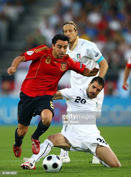Simone Perrotta of Italy tackles Xavi Hernandez of Spain during the UEFA EURO 2008 Quarter Final match between Spain and Italy at Ernst Happel...