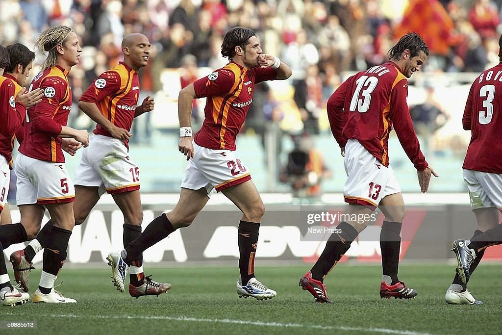 Simone Perrotta #20 of Roma celebrates with team mates during the Serie A match between AS Roma and Empoli at the Stadio Olimpico on February 19, 2005 in Rome, Italy.