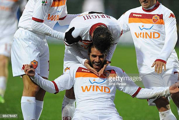 Simone Perrotta of Roma celebrates with teammtaes after scoring the second goal for their team during the Serie A match between Atalanta BC and AS...