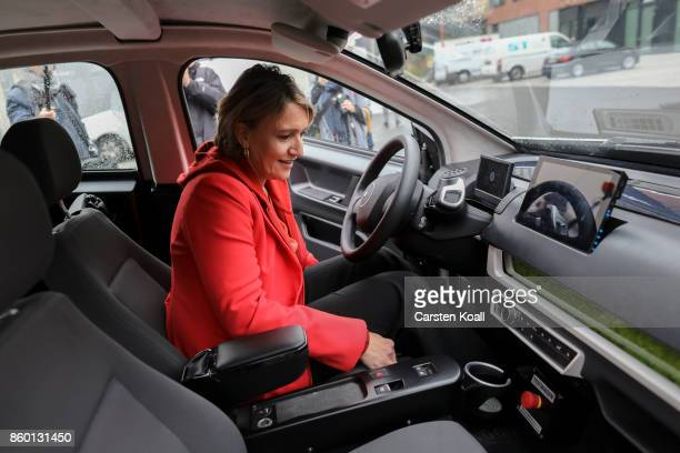 Simone Peter a leading member of the German Greens Party prepares to test drive a Sono Motors Sion solarpowered electric car on October 11 2017 in...