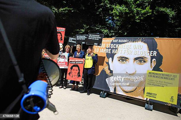 Simone Peter Federal Chairman of Buendnis 90/ Die Gruenen and Klaus Staeck demonstrate outside the Saudi Arabian Embassy against the recent Saudi...