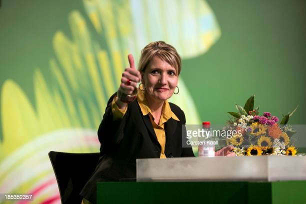 Simone Peter one of the two newelected coleaders of the German Greens Party sits with flowers at a federal conference of Greens Party delegates on...