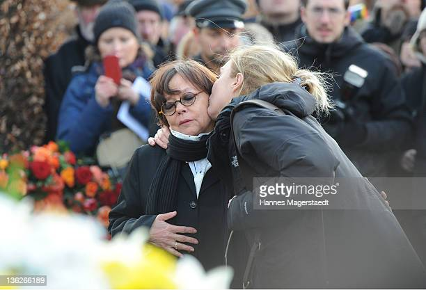 Simone RethelHeesters is kissed by Saskia Fischer during the memorial service for Johannes 'Jopie' Heesters at the Nordfriedhof on December 30 2011...