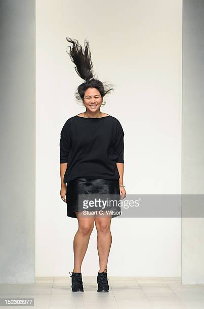Simone Rocha appears on the catwalk by after her show on day 5 of London Fashion Week Spring/Summer 2013 at The Courtyard Showspace on September 18...