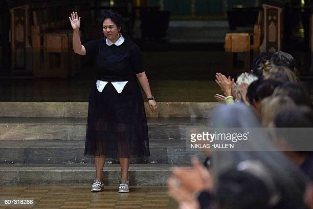 Simone Rocha greets the crowd after presenting her collection during the 2017 Spring / Summer catwalk show at London Fashion Week in London on...