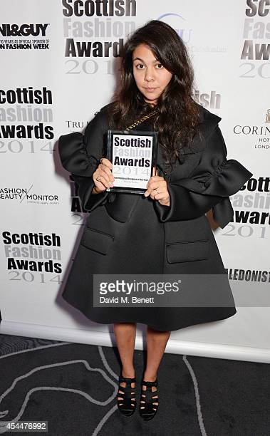 Simone Rocha poses after winning the International Designer of the Year award during the Scottish fashion invasion of London at the 9th annual...