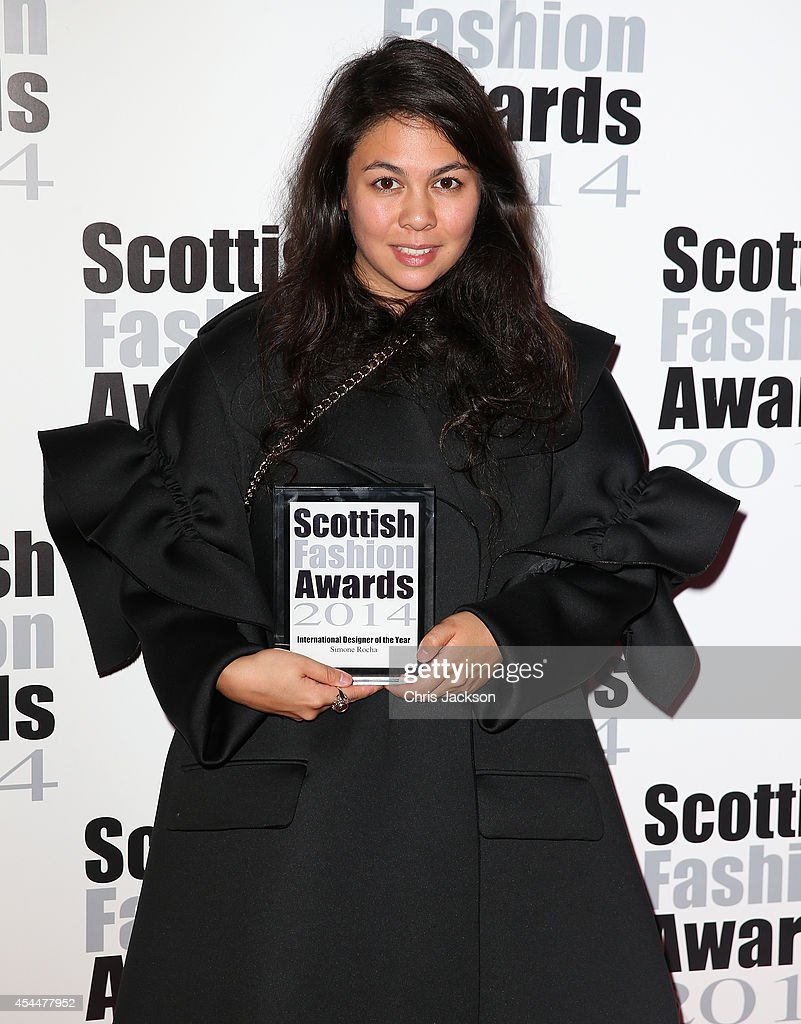 Simone Rocha poses with the International Designer Award as she attends The Scottish Fashion Awards on September 1, 2014 in London, England.