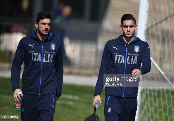 Simone Scuffet and Alex Meret of Italy look on prior to the training session at the club's training ground at Coverciano on April 11 2017 in Florence...