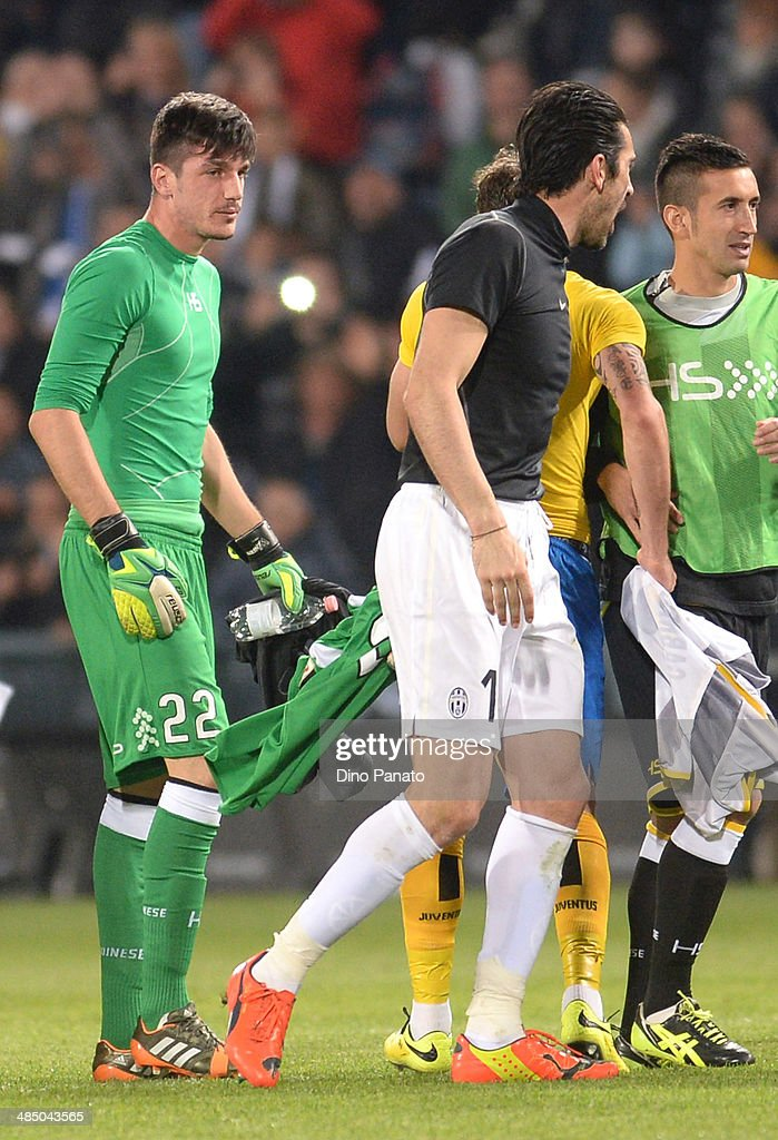 Simone Scuffet (L), goalkeeper of Udinese Calcio and Gianluigi Buffon, goalkeeper of Juventus after the Serie A match between Udinese Calcio and Juventus at Stadio Friuli on April 14, 2014 in Udine, Italy.
