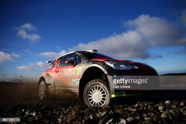 Simone Tempestini of Romania drives with codriver Giovanni Bernacchini of Italy during day one of the FIA World Rally Championship Great Britain on...