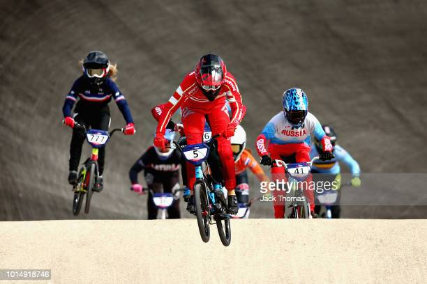 Simone Tetsche Christensen of Denmark leads the field in Heat 2 of the Women's Semi Final during the BMX on Day Ten of the European Championships...