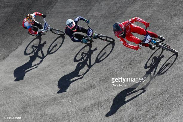 Simone Tetsche Christensen of Denmark Manon Valentino of France and Natalia Afremova of Russia compete in the Women's BMX Motos heats during the BMX...