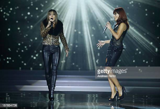 Simone Thomalla and Andrea Berg perform on stage during the Andrea Berg 'Die 20 Jahre Show' at Baden Arena on December 6 2012 in Offenburg Germany
