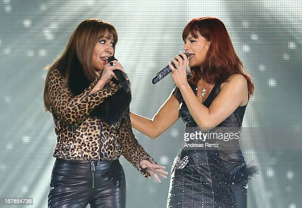 Simone Thomalla and Andrea Berg perform on stage during the Andrea Berg 'Die 20 Jahre Show' at Baden Arena on December 6, 2012 in Offenburg, Germany.
