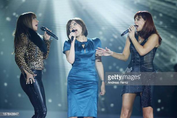 Simone Thomalla, Birgit Schrowange and Andrea Berg perform on stage during the Andrea Berg 'Die 20 Jahre Show' at Baden Arena on December 6, 2012 in...