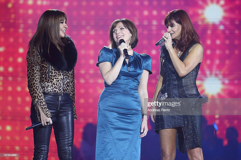 Simone Thomalla, Birgit Schrowange and Andrea Berg perform on stage during the Andrea Berg 'Die 20 Jahre Show' at Baden Arena on December 6, 2012 in Offenburg, Germany.