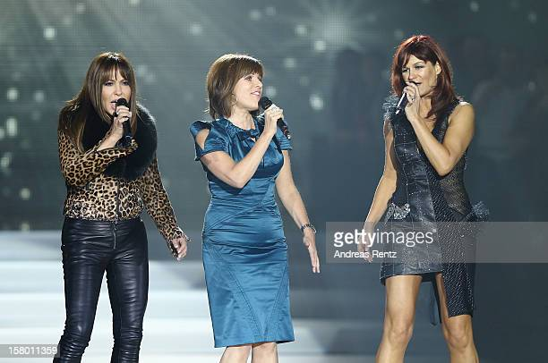 Simone Thomalla, Birgit Schrowange and Andrea Berg perform on stage during the Andrea Berg 'Die 20 Jahre Show' at Baden Arena on December 7, 2012 in...