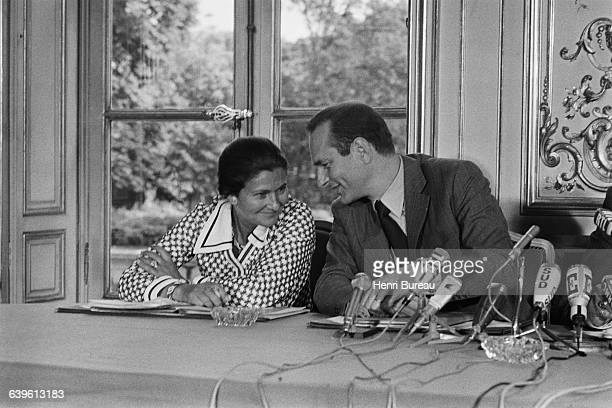 Simone Veil and Prime Minister Jacques Chirac attend a press conference at Matignon to present the new social plan adopted by the government