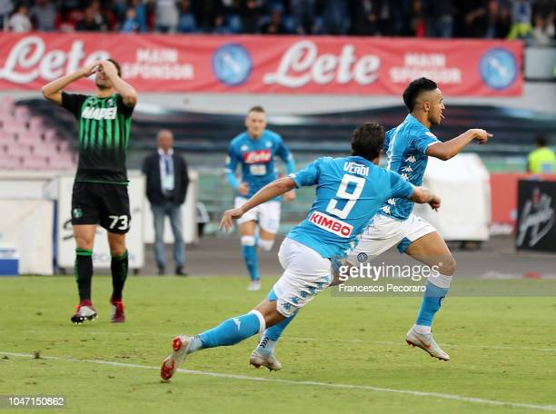 Simone Verdi and Adam Ounas of SSC Napoli celebrate the 10 goal scored by Adam Ounas during the Serie A match between SSC Napoli and US Sassuolo at...