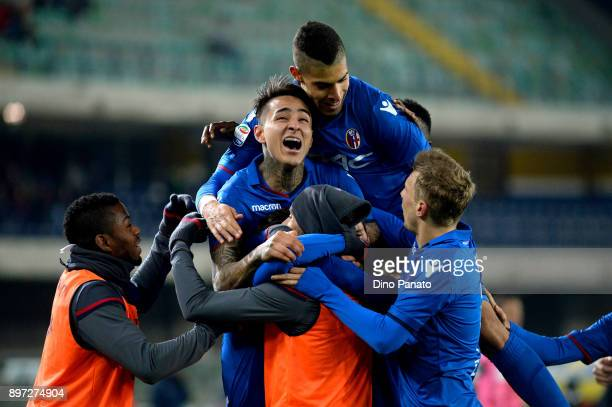 Simone Verdi Bologna FC is mobbed by team mates after scoring his team's second goal during the serie A match between AC Chievo Verona and Bologna FC...