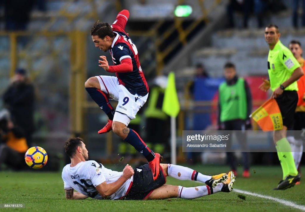 Simone Verdi of Bologna FC competes for the ball whit Artur Ionita of Cagliari Calcio during the Serie A match between Bologna FC and Cagliari Calcio at Stadio Renato Dall'Ara on December 3, 2017 in Bologna, Italy.