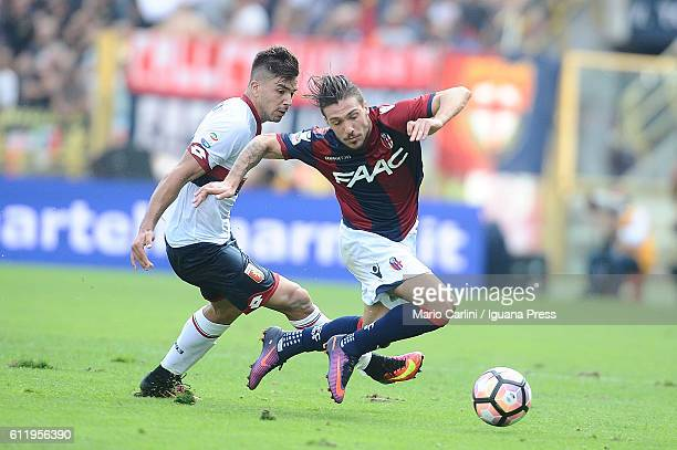 Simone Verdi of Bologna FC competes the ball with Giovanni Simeone of Genoa CFC during the Serie A match between Bologna FC and Genoa CFC at Stadio...
