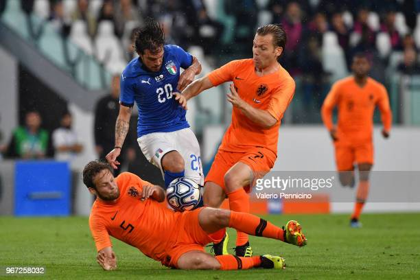 Simone Verdi of Italy competes for the ball with Daley Blind and Hans Hateboer of Netherlands during the International Friendly match between Italy...