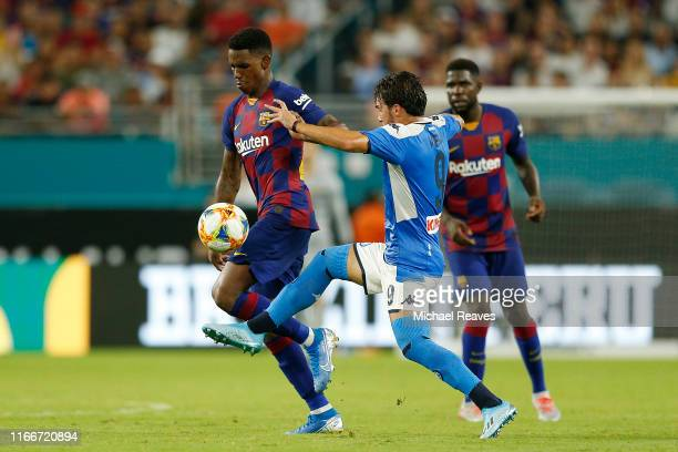 Simone Verdi of SSC Napoli battles for the ball with Ousmane Dembele of FC Barcelona during the second half of a preseason friendly match at Hard...