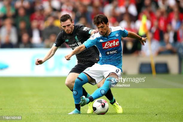 Simone Verdi of SSC Napoli is challenged by Andy Robertson of Liverpool during the PreSeason Friendly match between Liverpool FC and SSC Napoli at...