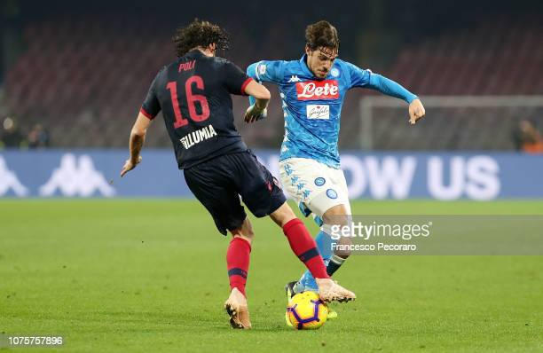 Simone Verdi of SSC Napoli vies Andrea Poli of Bologna FC during the Serie A match between SSC Napoli and Bologna FC at Stadio San Paolo on December...