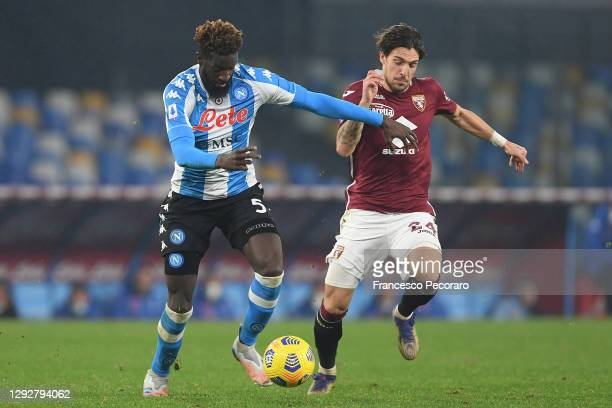 Simone Verdi of Torino battles for possession with Tiemoue Bakayoko of SSC Napoli during the Serie A match between SSC Napoli and Torino FC at Stadio...