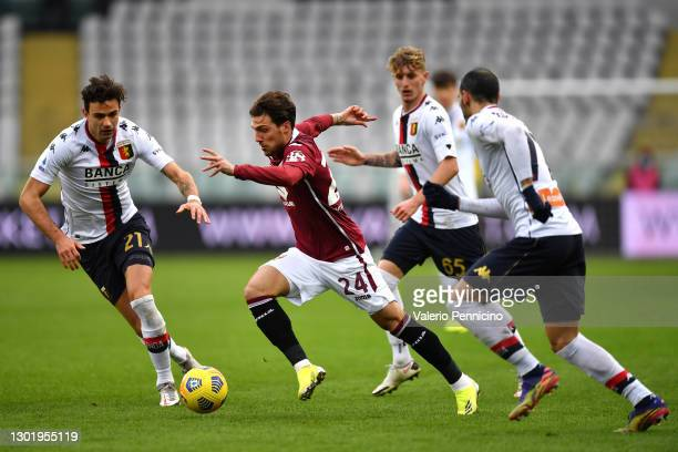 Simone Verdi of Torino FC breaks with the ball under pressure from Ivan Radovanovic of Genoa C.F.C. During the Serie A match between Torino FC and...