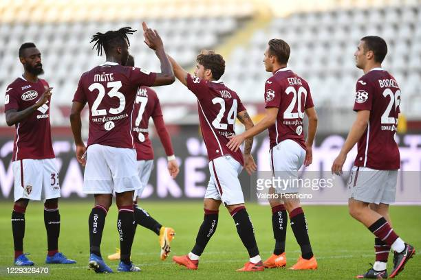 Simone Verdi of Torino FC celebrates a goal with team mates during the Coppa Italia match between Torino FC and US Lecce at Stadio Olimpico Grande...