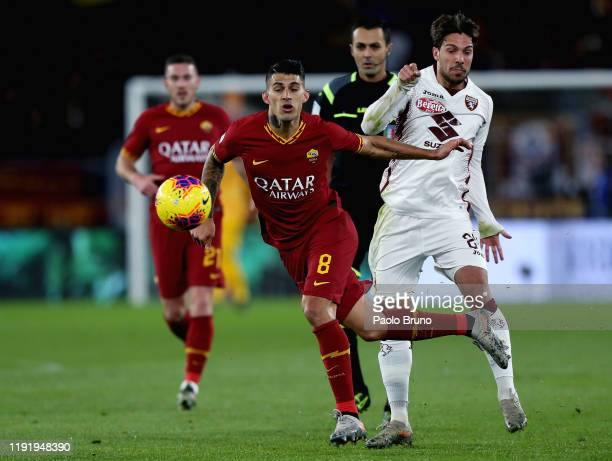 Simone Verdi of Torino FC competes for the ball with Diego Perotti of AS Roma during the Serie A match between AS Roma and Torino FC at Stadio...