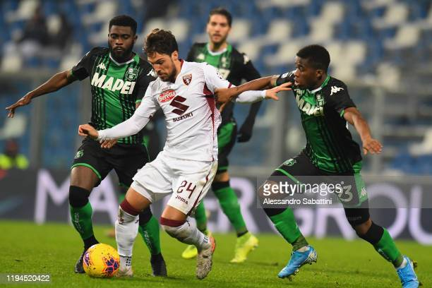Simone Verdi of Torino FC competes for the ball with Jeremie Boga and Hamed Junior Traore of US Sassuolo during the Serie A match between US Sassuolo...