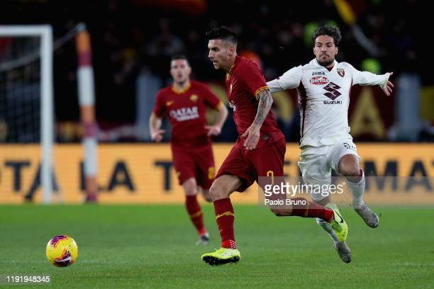 Simone Verdi of Torino FC competes for the ball with Lorenzo Pellegrini of AS Roma during the Serie A match between AS Roma and Torino FC at Stadio...
