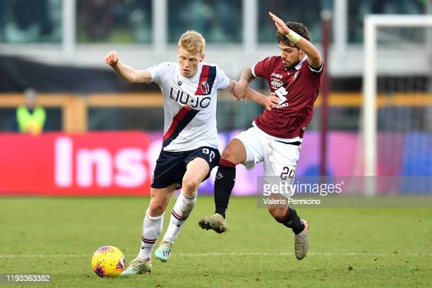 Simone Verdi of Torino FC competes with Jerdy Schouten of Bologna FC during the Serie A match between Torino FC and Bologna FC at Stadio Olimpico di...