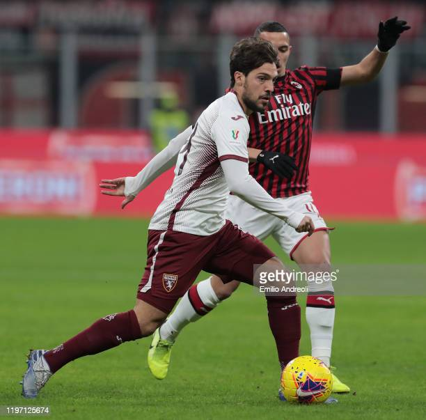 Simone Verdi of Torino FC is challenged by Ismael Bennacer of AC Milan during the Coppa Italia Quarter Final match between AC Milan and Torino at San...