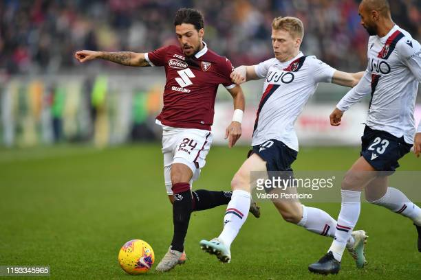 Simone Verdi of Torino FC is challenged by Jerdy Schouten of Bologna FC during the Serie A match between Torino FC and Bologna FC at Stadio Olimpico...
