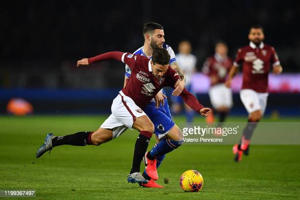 Simone Verdi of Torino FC is challenged by Nicola Murru of UC Sampdoria during the Serie A match between Torino FC and UC Sampdoria at Stadio...