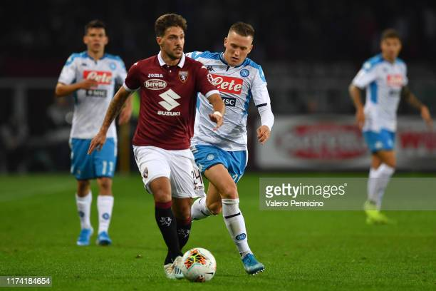 Simone Verdi of Torino FC is challenged by Piotr Zielinski of SSC Napoli during the Serie A match between Torino FC and SSC Napoli at Stadio Olimpico...
