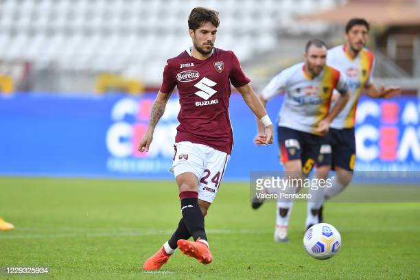 Simone Verdi of Torino FC scores his goal from the penalty spot during the Coppa Italia match between Torino FC and US Lecce at Stadio Olimpico...