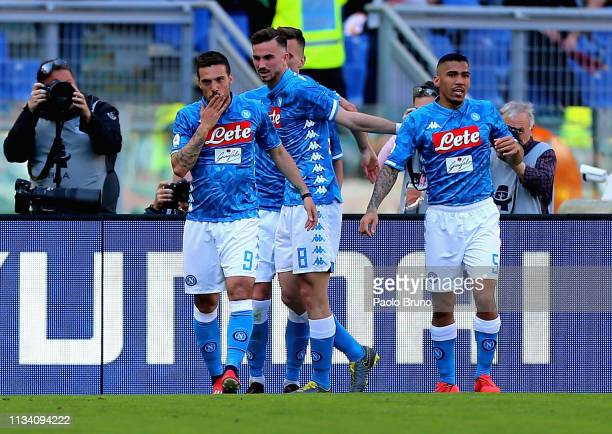 Simone Verdi with his teammates of SSC Napoli celebrates after scoring the team's third goal during the Serie A match between AS Roma and SSC Napoli...