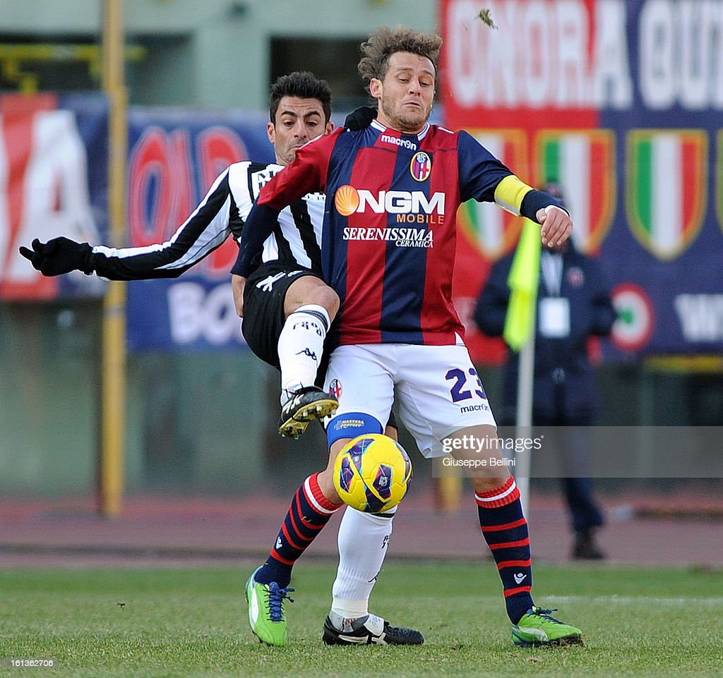 Simone Vergassola of Siena and Alessandro Diamanti of Bologna in action during the Serie A match between Bologna FC and AC Siena at Stadio Renato Dall'Ara on February 10, 2013 in Bologna, Italy.