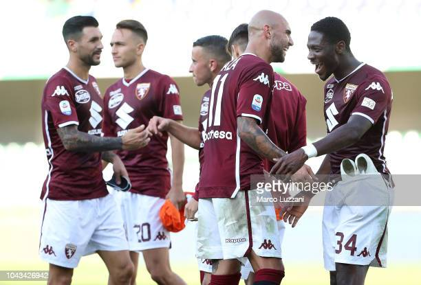 Simone Zaza and Ola Aina of Torino FC celebrate a victory at the end of the Serie A match between Chievo Verona and Torino FC at Stadio Marc'Antonio...