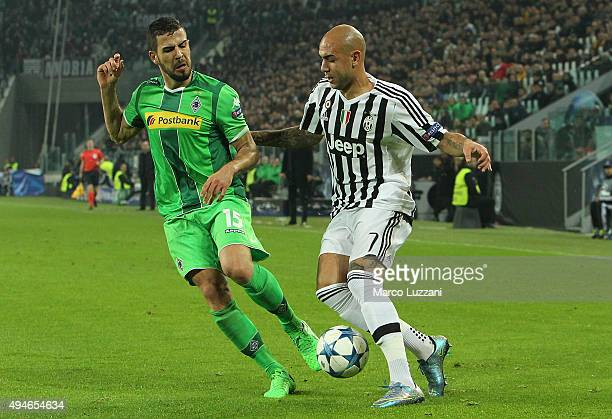 Simone Zaza of Juventus competes for the ball with Alvaro Dominguez of VfL Borussia Monchengladbach during the UEFA Champions League group stage...