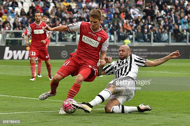 Simone Zaza of Juventus FC is tackled by Simone Romagnoli of Carpi FC during the Serie A match between Juventus FC and Carpi FC at Juventus Arena on...